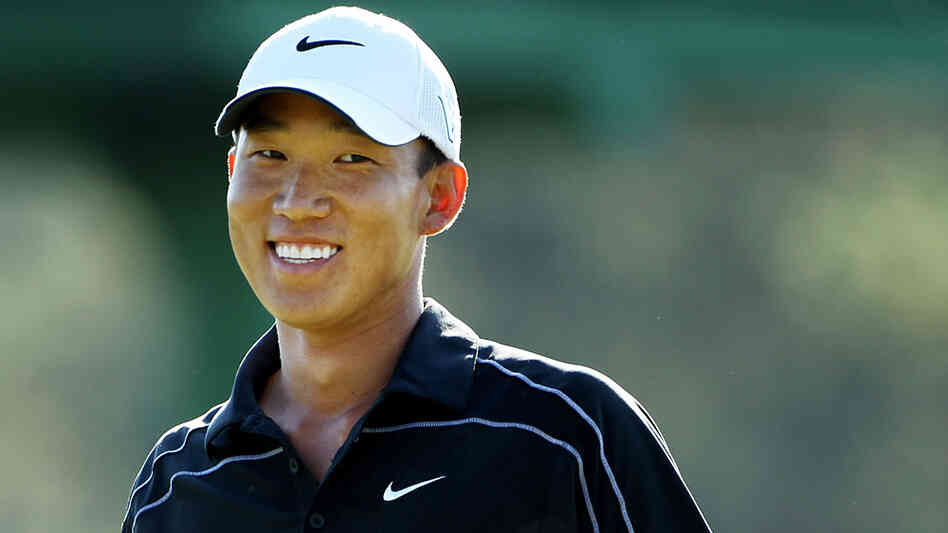 Anthony Kim smiles to the gallery on the 17th green during the final round of the 2010 Masters Golf