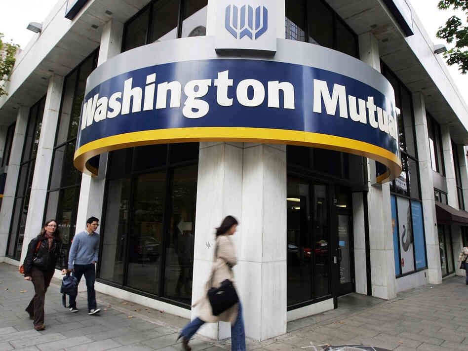 People walk past a Washington Mutual bank branch in Seattle in 2008.
