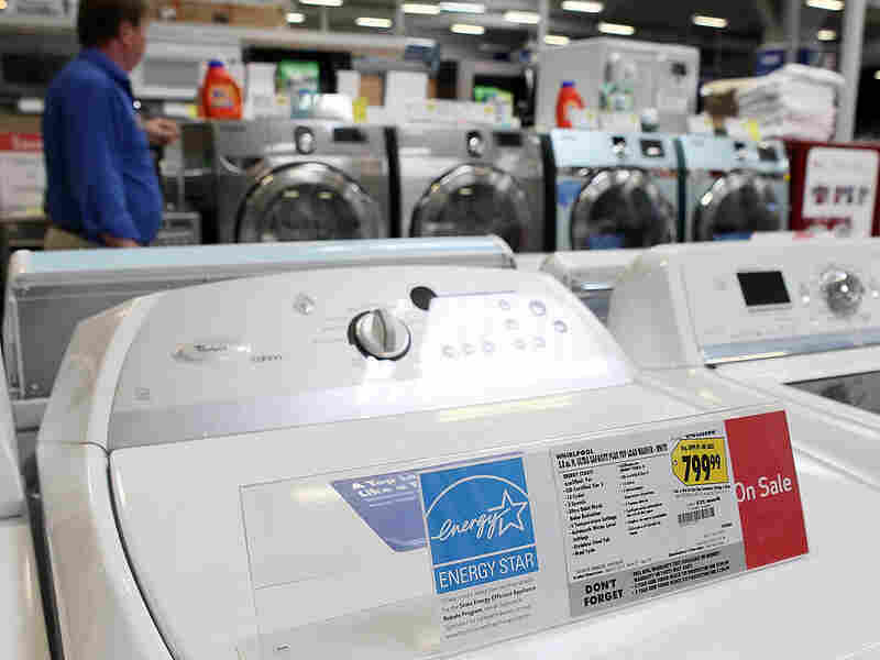 An Energy Star label is displayed on a washing machine at a Best Buy store.