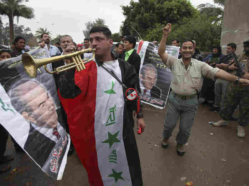 Supporters of former Iraqi Prime Minister Ayad Allawi