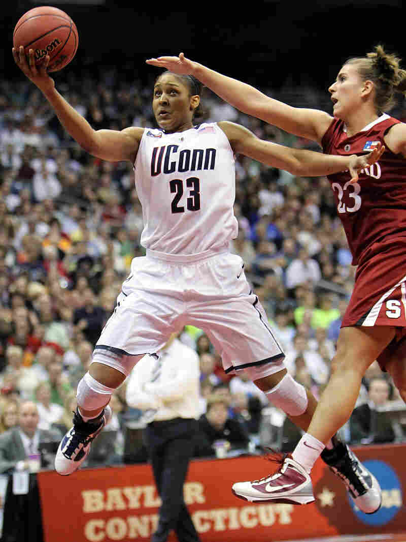 Maya Moore of the Connecticut Huskies takes a shot against Jeanette Pohlen of the Stanford Cardinal.