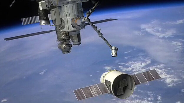 The Dragon spacecraft approaches the International Space Station