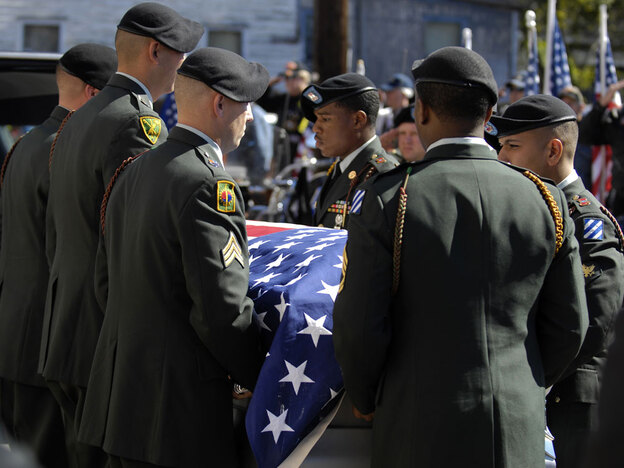 An Army Honor Guard prepares to carry the flag-draped coffin of Staff Sgt. Vernon Martin into St. John's Baptist Church for his funeral service on Oct. 19, 2009, in Savannah, Ga. Martin, 25, was one of eight U.S. soldiers killed Oct. 3 during a fierce battle at Combat Outpost Keating in Afghanistan.