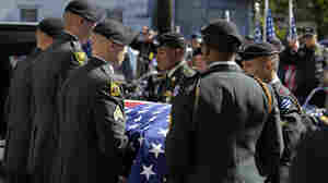 An Army Honor Guard prepares to carry the coffin of Staff Sgt. Vernon Martin