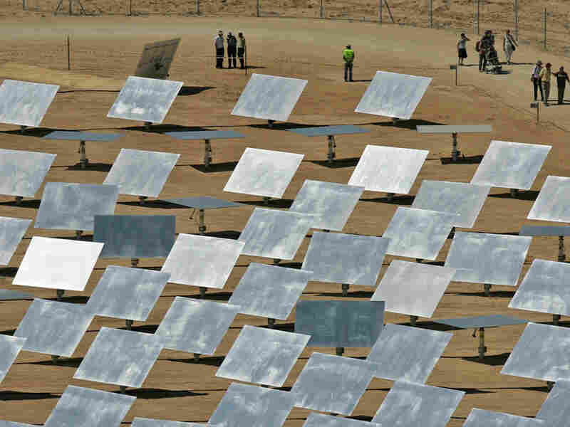 People tour a solar field of mirrors in Dimona, Israel.