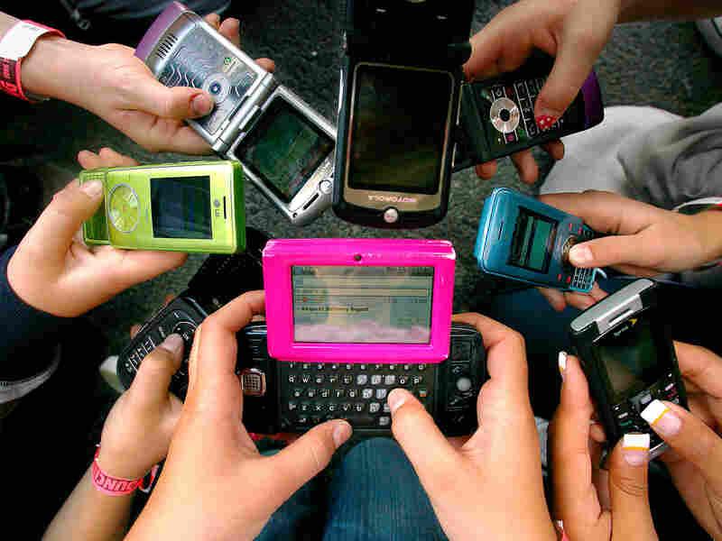 Granite Elementary School sixth grade students hold up their cell phones in Sandy, Utah.