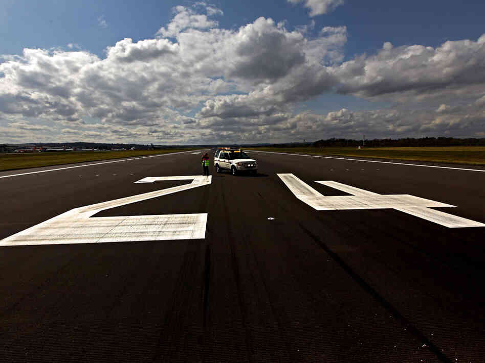 An airport vehicle on an empty runway in Edinburgh.