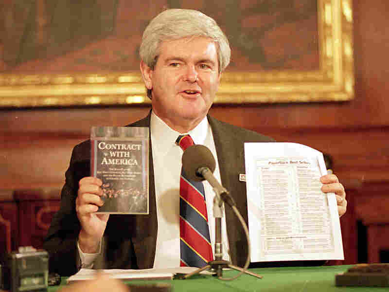 Then-House Speaker Newt Gingrich holds up his 'Contract With America'