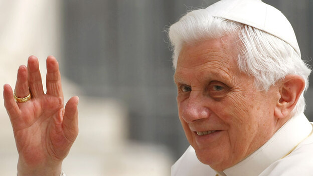 Pope Benedict XVI waves from the popemobile (AP)