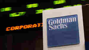 A stock ticker near the Goldman Sachs booth on the floor of the New York Stock Exchange