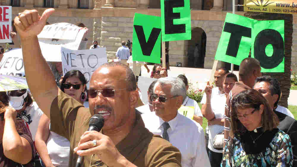 Activists protest Arizona's sweeping new immigration crackdown bill during a rally Tuesday.