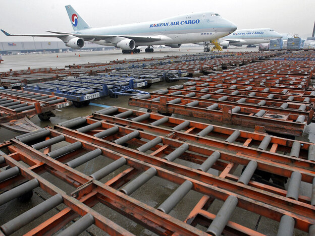 Korean Air cargo planes sit idle on the tarmac at the Incheon International Airport in Incheon, west of Seoul, South Korea, on Monday. Every day, on average, 10,000 tons of goods are airfreighted between Asia and Europe. But none of that has moved for the past week after Iceland's volcanic eruption.