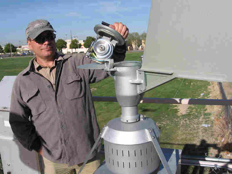 Dan Gates, with Albuquerque's Air Quality Division, measures pollen in the air.