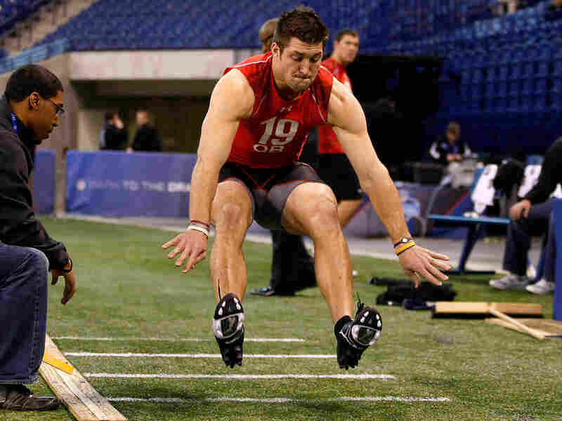 Quarterback Tim Tebow performs the long jump at the NFL Scouting Combine in Indianapolis, Feb. 28.