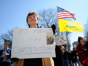 Kathleen Gudaitis, of Johnston, R.I., protests against the health care reform bill.