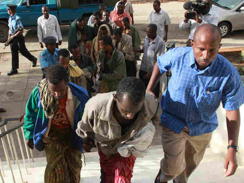 Under heavy guard, eleven Somali suspected pirates were brought to the Mombasa court Kenya.