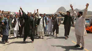 Afghan protesters shout anti-American slogans during a protest in Kandahar.
