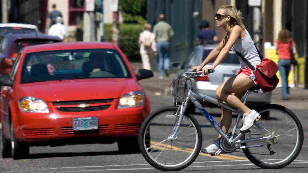 A bicyclist pedals through an intersection