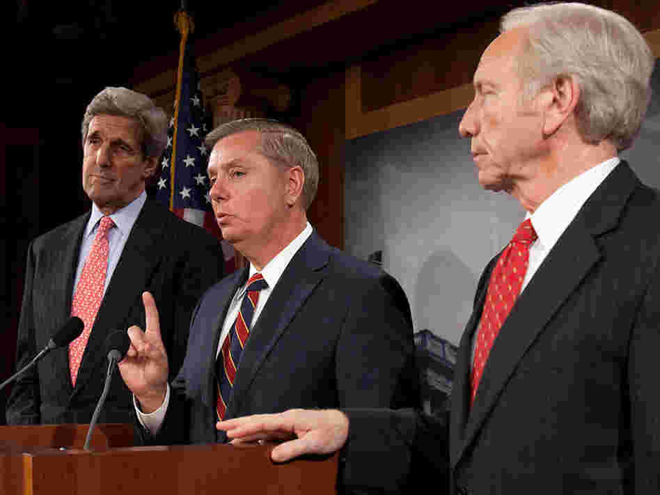Sens. John Kerry (left) and Joseph Lieberman (right) and Sen. Lindsey Graham