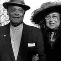 A couple poses outside of Lexington, Ky.