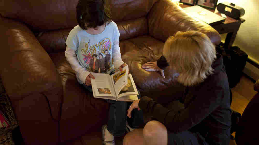 Isabelle reads a book with her mom