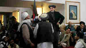 Afghan President Hamid Karzai speaks to locals