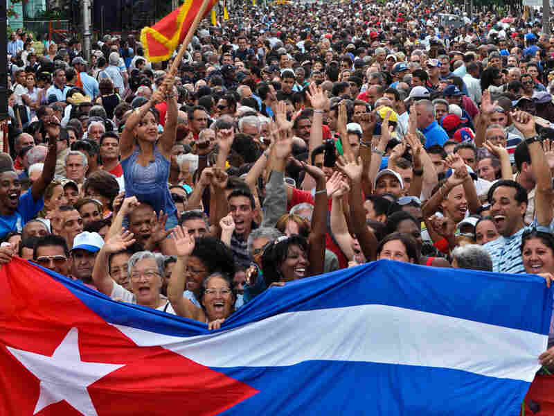 Cubans in Havana celebrate the 49th anniversary of the socialist nature of their revolution