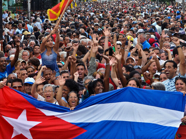 "Cubans in Havana's El Vedado neighborhood celebrate on April 16, the 49th anniversary of Fidel Castro's declaration of the ""socialist"" character of the Cuban Revolution."