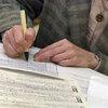 A job-seeker fills out an application at a senior job fair in Palatine, Ill., in 2003.