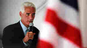 Florida Gov. Charlie Crist with an American flag