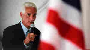 Florida Gov. Charlie Crist with an American flag