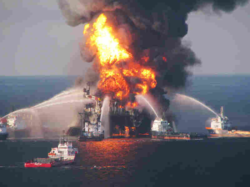 Fire boats battle a fire at the off shore oil rig Deepwater Horizon