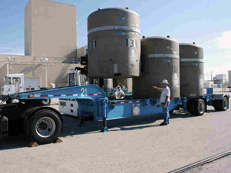At the Waste Isolation Pilot Plant, an empty waste container is loaded onto a trailer.