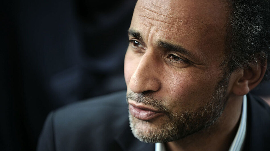 Muslim scholar Tariq Ramadan, pictured here at a conference in France on April 25, is now able to enter the U.S. He tells NPR that when he speaks in the U.S., he's too much of a Muslim and when he speaks in the Muslim world, he's too much of a Westerner.