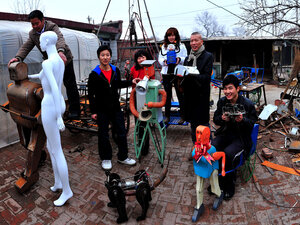 Inventor Wu Yulu and his family with their various robots.