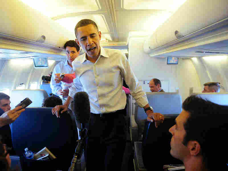 Ari Shapiro (lower right) on Air Force One with President Obama. Jewel Samad/AFP/Getty Images