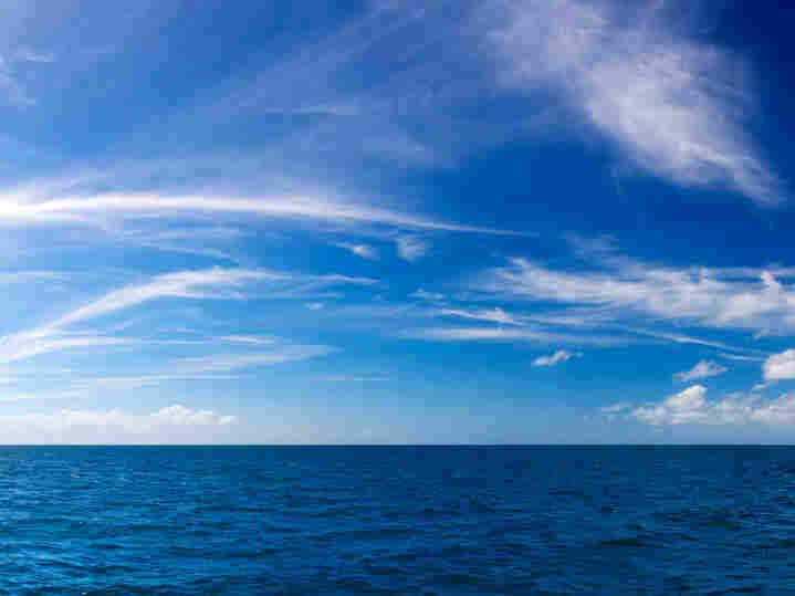 Blue sky over an ocean. iStockphoto.com