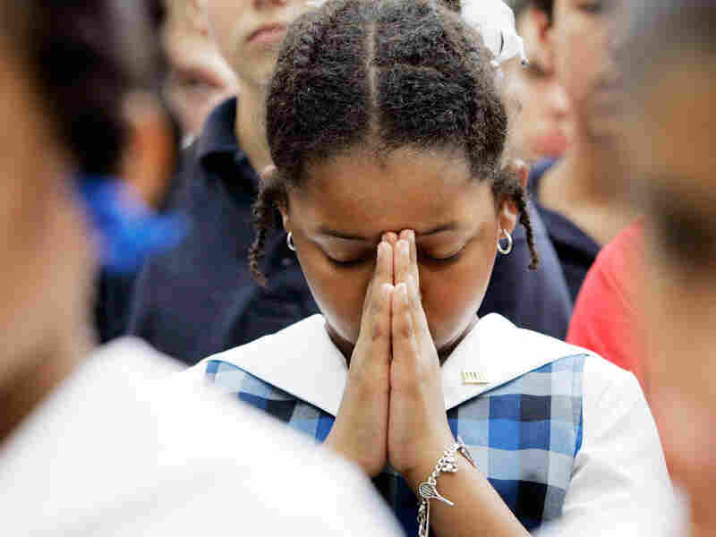 Alexandria McPherson, 8, prays during a National Day of Prayer gathering in 2007.