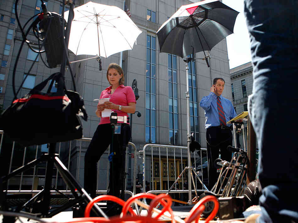 Television crews prepare to broadcast outside Manhattan Federal Court in New York.