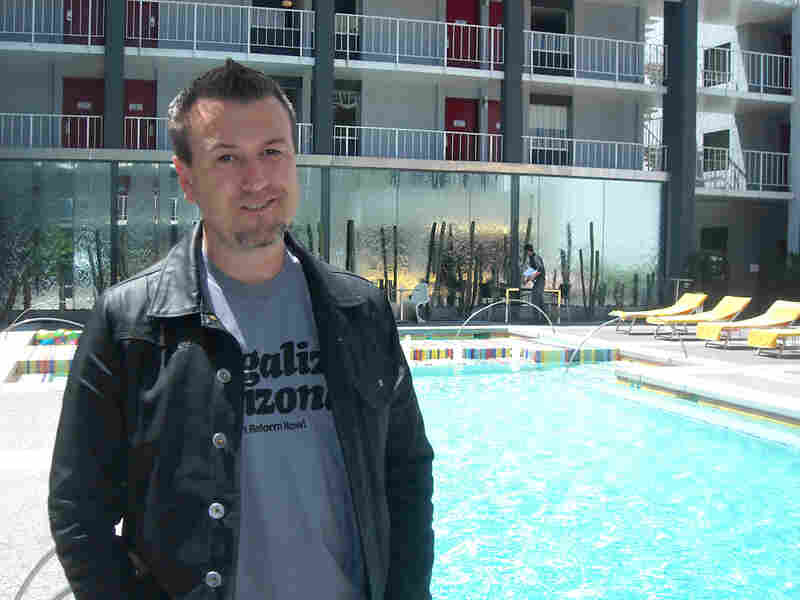 Ben Bethel stands in front of the pool at the Clarendon Hotel in Phoenix.