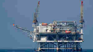 An offshore oil rig is seen in a channel  near Long Beach, Calif.
