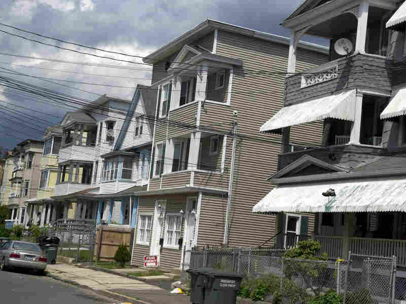 The home of Faisal Shahzad (second from right) is seen Tuesday in Bridgeport, Conn.