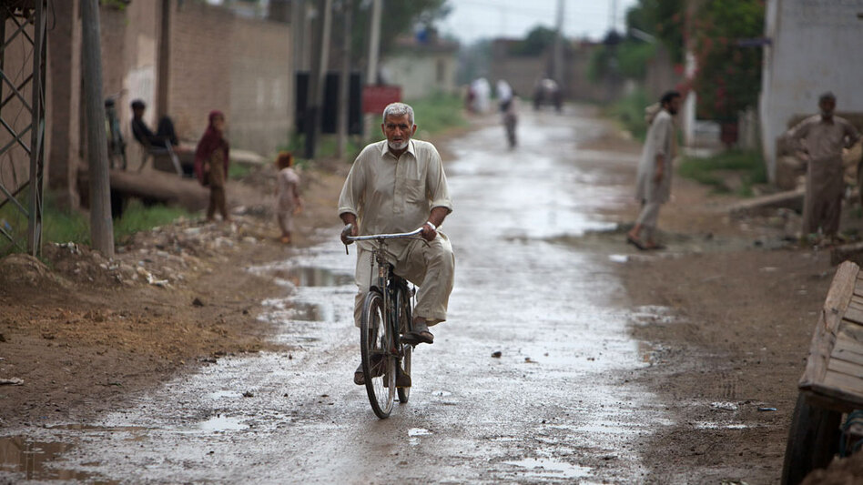 A man rides down the central road in Mohib Banda, the small village in Pakistan's Northwest Frontier Province that is the ancestral home of Faisal Shahzad's family. People in the village expressed shocked over the allegations against Shahzad.