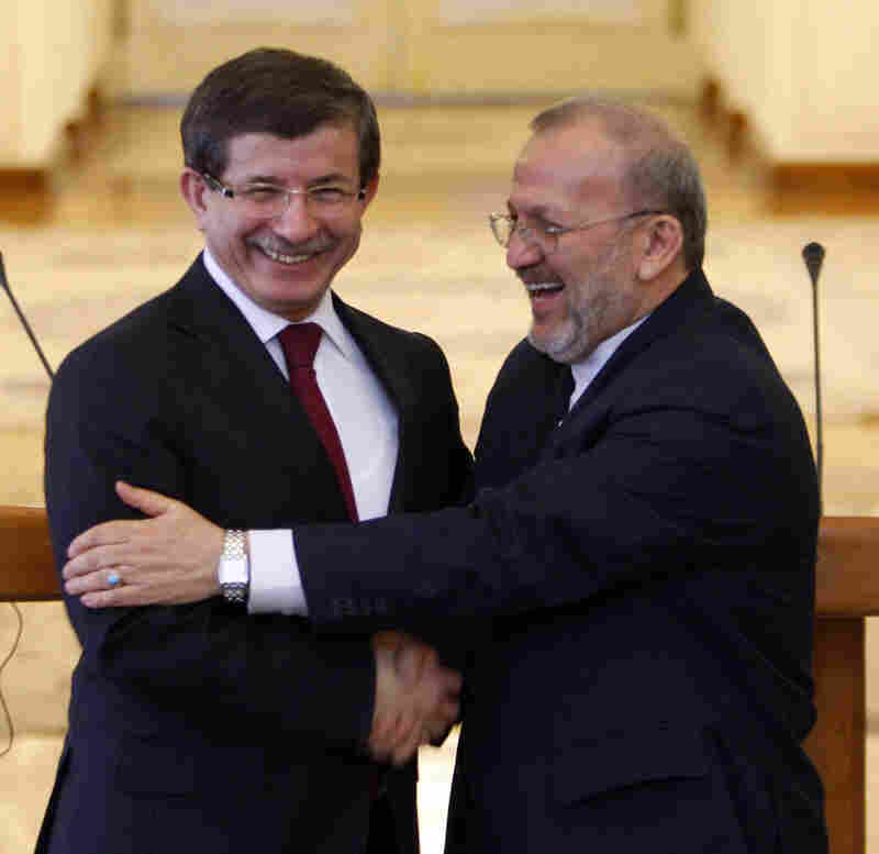 Turkish Foreign Minister Ahmet Davutoglu and his Iranian counterpart, Manouchehr Mottaki
