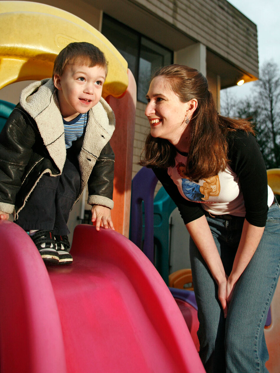 Selena Allen watches her son, Connor, as he prepares to go down a slide in 2007. Connor was born prematurely in April 2003, and Allen had to return to work just a few days after his birth.