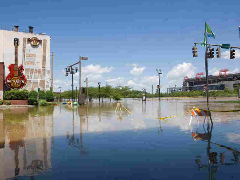 Floodwaters cover a downtown street in Nashville