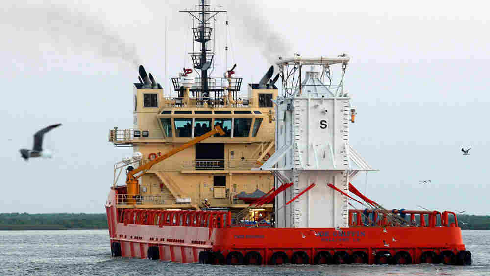 The barge Joe Griffin carries the 100-ton containment chamber into the Gulf of Mexico.