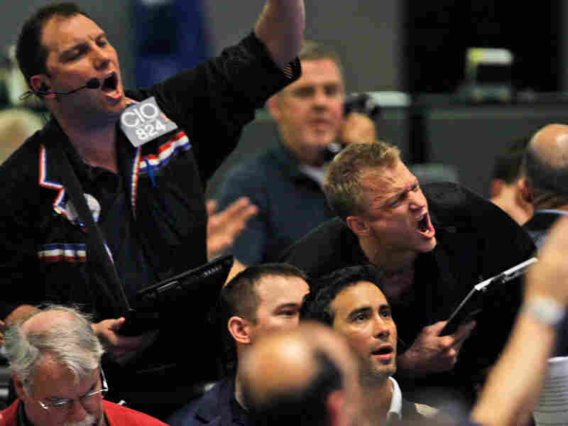 Traders shout orders in the S&P 500 futures pit at the CME Group in Chicago.