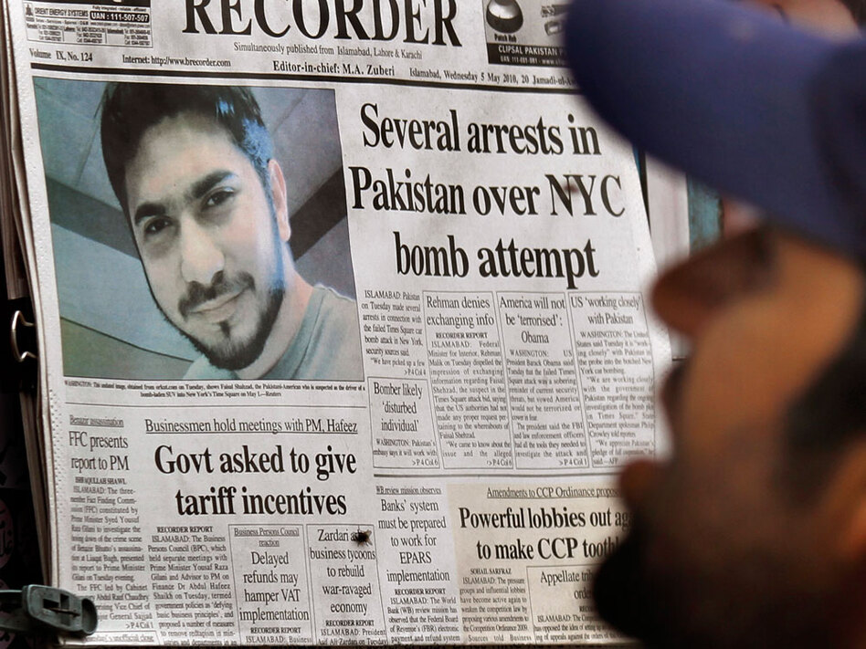 A Pakistani man reads a morning newspaper carrying the headline story on the arrest of a suspect in the Times Square bomb attempt, at a newspaper stall in Islamabad, Pakistan on Wednesday.
