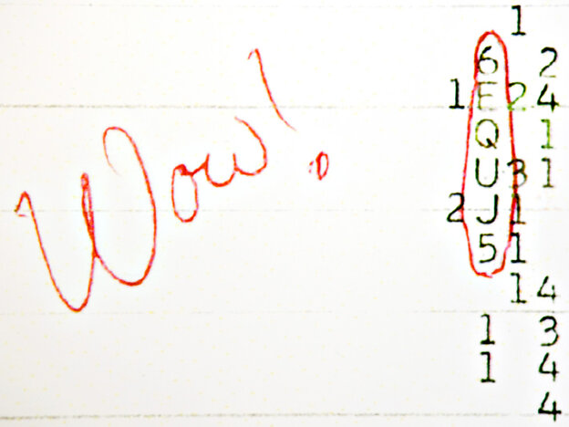 """The word """"Wow!"""" is scrawled in red next to a row of numbers on a computer printout"""